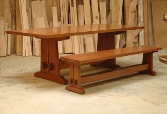 American-Cherry-Trestle-Bench-and-Table-with-cable-management-grommets-angled-view