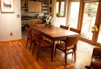 Western-Walnut-Table-and-Finn-Juhl-Inspired-Dining-Chairs-angle