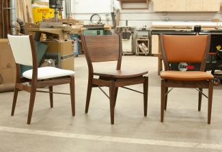 Three-Western-Walnut-and-Leather-Finn-Juhl-Inspired-Dining-Chairs-chairs
