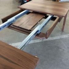 Western-Walnut-Finn-Juhl-inspired-extension-Table-self-storing-leaf